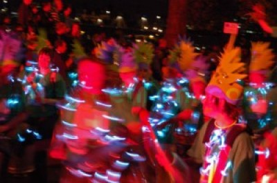 night carnival group with hats and blue lights