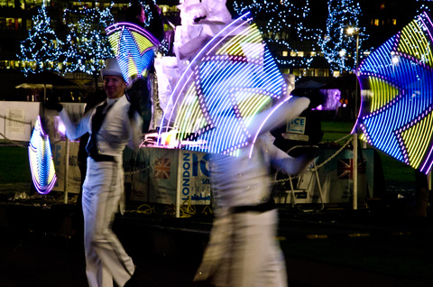 Fan dancers with led lights at London Ice Sculpting Festival 2013 Canary Wharf