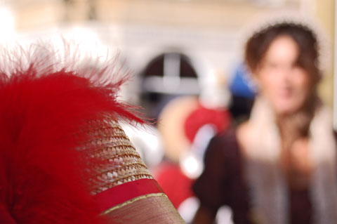 close up of red feather on hat at Jane Austen Festival