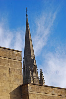 church spire in Bath with wispy white cloud and blue sky