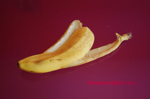 banana skin on green background