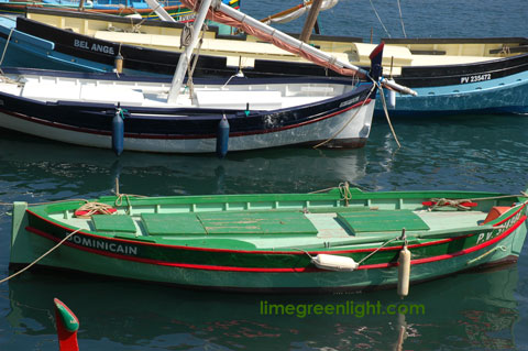 three small boats in Collioure Harbour France