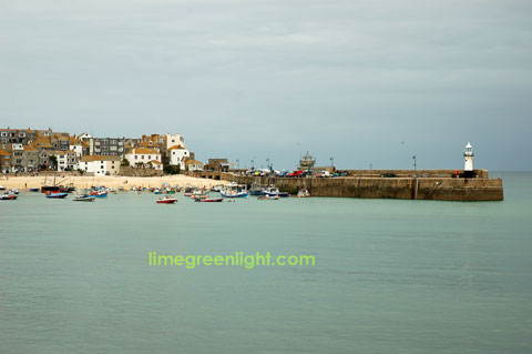 St Ives Harbour with grey sky and pale green sea