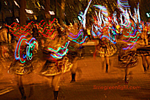 colourful dancers in London Night Carnival at 2009 Thames Festival