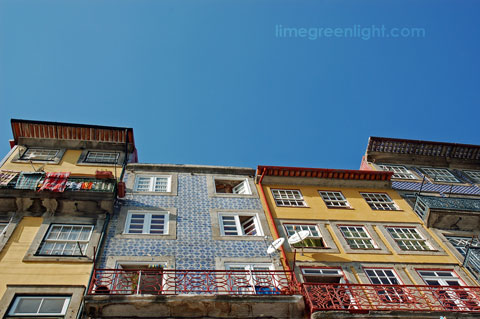houses in Oporto contrasting with bright blue sky