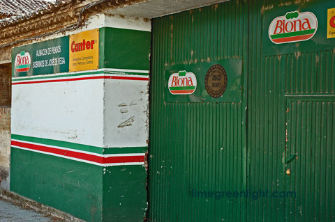 closed shop with green doors in Spain