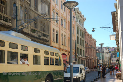 trolley bus in Valparaiso with child leaning out of window