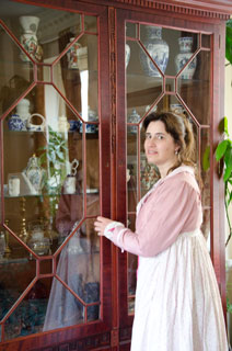 Jane Austen fan at the china cabinet in regency house in Bath 2011