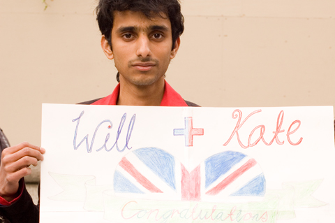 man with sign saying congratulations to william and kate