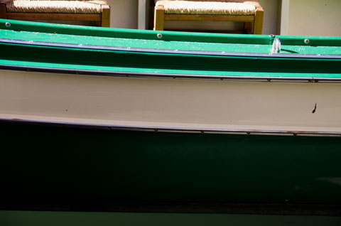 green and white boat on Venice canal